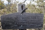 Guy ponders the trail sign