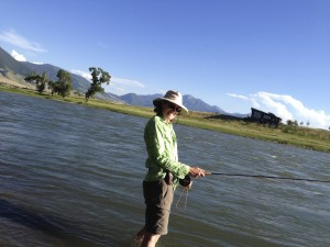 Jen fly fishes on the Yellowstone River, Loch Leven Fishing Access, Livingston, Montana