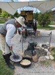 Top cookie Ron Reed whips up a stellar feed of sourdough biscuits and cowboy coffee outside Buffalo Bill Center of the West, Cody, Wyoming