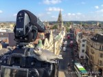 Jen and Guy shoot video from the top of Carfax Tower in Oxford, England