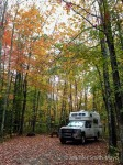 Snowy camps under a canopy of fall foliage at Camden Hills State Park, Camden, Maine