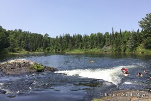 Folks cool off with a swim in the Serpent River, Ontario, Canada